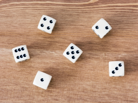 dice: Casino dices on a wooden table. Straight.