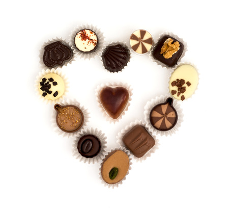 Valentines heart made of delicious chocolate pralines. photo
