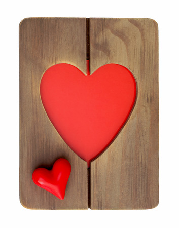 Red valentine heart in wooden frame on a white background. photo