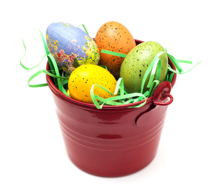 Red bucket with colorful easter eggs  photo