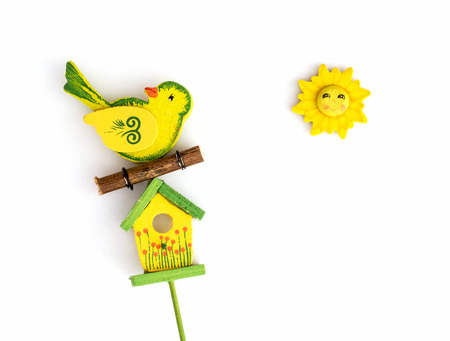 Yellow bird with birdhouse and sun.  photo