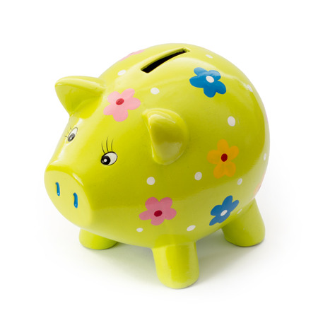 Painted ceramic piggy bank on a white background. Stockfoto