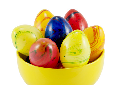 eastertime: Ceramic easter eggs in the yellow bowl on a white background. Stock Photo