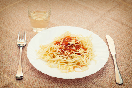 Tasty spaghetti with drink on the table. photo