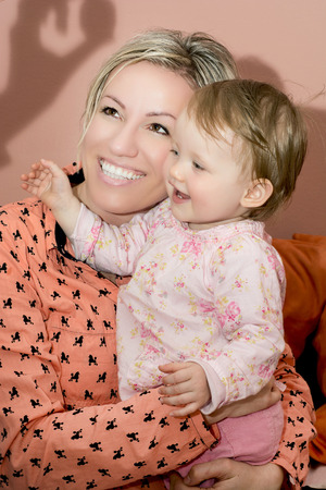 caucasian woman: European caucasian woman with her little daughter are very joyful. Stock Photo