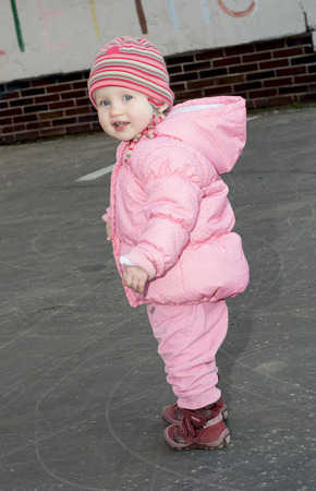 caucasian girl: Little caucasian girl on a walk.