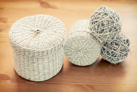 Set of white seagrass basket on a wooden table. photo