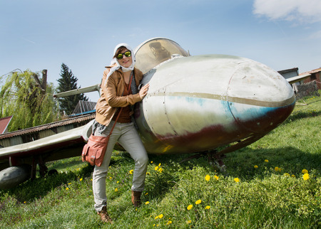 Young caucasian woman and old airplane. photo