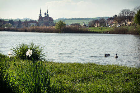 Velehrad basilica with blooming daffodils by the lake, Czech Republic, Central Europe. Horizontal composition. Stock Photo - 29292147