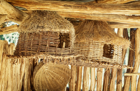 Various wicker bird houses and baskets for sale. photo