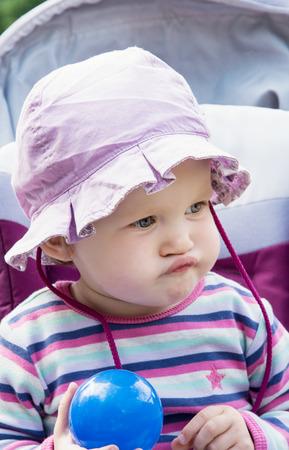 caucasian girl: Little caucasian girl in the cute sun hat posing with blue ball.