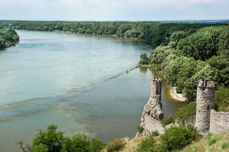 central europe: Maiden tower of Devin castle and confluence of the Danube with Morava rivers. Slovak republic, Central Europe.