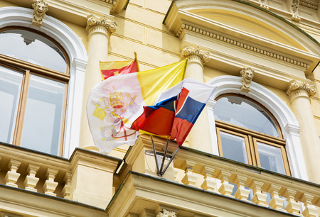 central europe: Slovak and Vatican flags on the building of the Great Seminary in Nitra, Slovakia, central Europe.