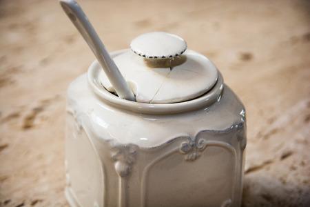 Cracked ceramic sugar bowl. Retro style. photo