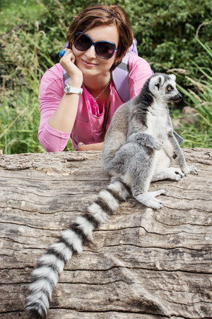 caucasian woman: Ring-tailed lemur (Lemur catta) and young caucasian woman. Stock Photo