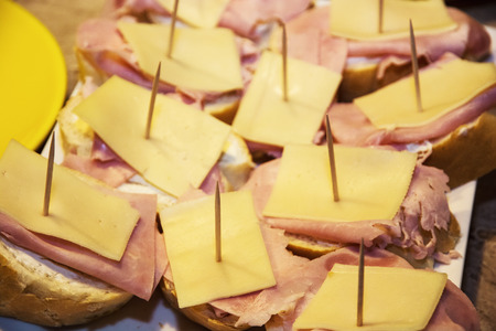 Tasty canapes with cheese, ham and butter. Food theme. photo