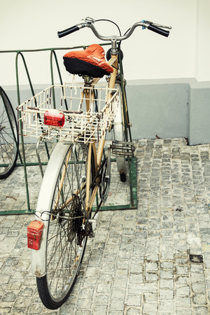 retro styled: Old retro styled bicycle with empty metal basket. Stock Photo