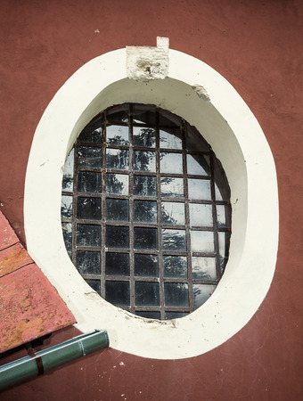 barred: Old barred window. Architectural element.