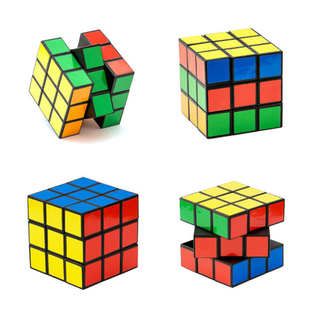 brain teaser: Nitra, Slovakia – November 17, 2013: Variation of the Rubiks cube on a white background. Rubiks Cube invented by a Hungarian architect Erno Rubik in 1974.