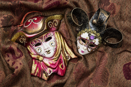 Two masquerade carnival masks on the fashionable background. photo