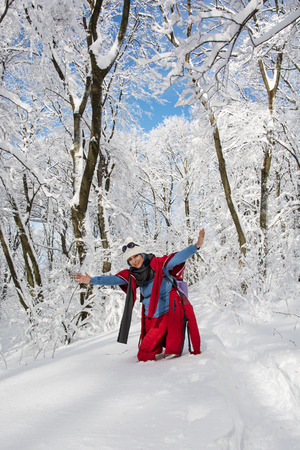 Young positive woman posing in snowy landscape. Winter theme. photo