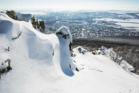 Snowy rocks with Nitra city in the background photo