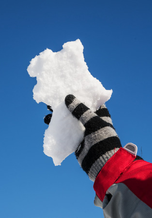 hand hold a Snow in the shape of Africa photo