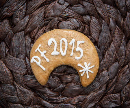 pour feliciter: The title PF 2015 written on gingerbread cookie. Wish card. Stock Photo