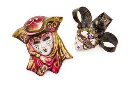 masquerade masks: Two beautiful masquerade carnival masks on the white background. Stock Photo