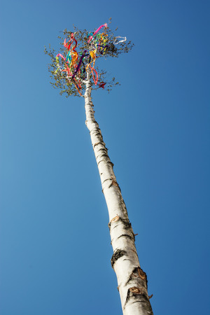 Looking up at beautiful symbolic may pole.