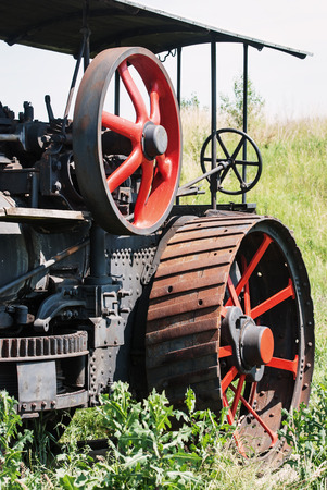 Old agricultural machine. Harvesting theme. photo