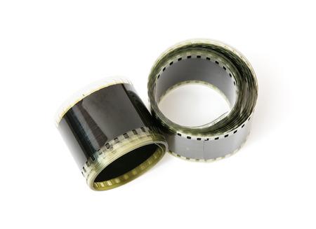 videocassette: Cinta de película de 8 mm en el fondo blanco.