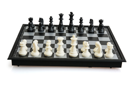 parlour games: Game of chess on the white background. Stock Photo