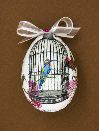 easteregg: Painted Easter egg with the hummingbird in the cage. Spring theme.