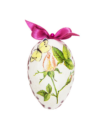 easteregg: Beautiful painted Easter egg with red bow. Spring time.
