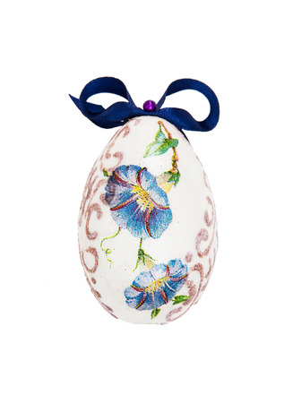 easteregg: Beautiful painted Easter egg with blue bow. Spring time.