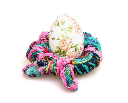 easteregg: Big Easter egg and colorful scarf on the white background. Spring time.