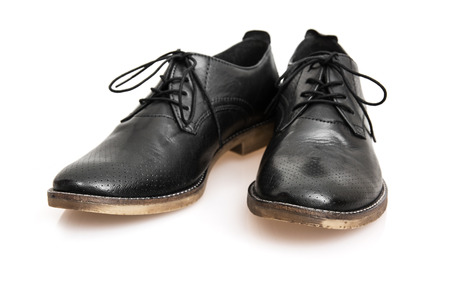 New black leather shoes on the white background. photo