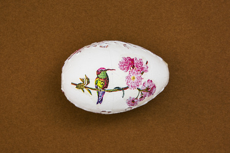 easteregg: Beautiful painted Easter egg with bird on the brown background. Spring time.