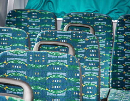 settle back: Empty seats in the bus. Travel theme.