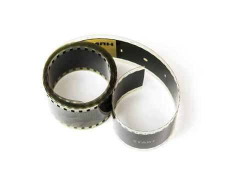 videocassette: Cinta de película de 8 mm en el fondo blanco. Tema de Cine.