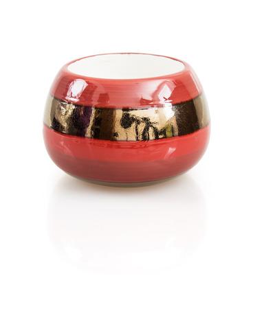 Stylish ceramic candlestick with reflection on the white background. photo
