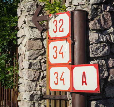 numeric: Numeric designation of houses in the city. Stock Photo