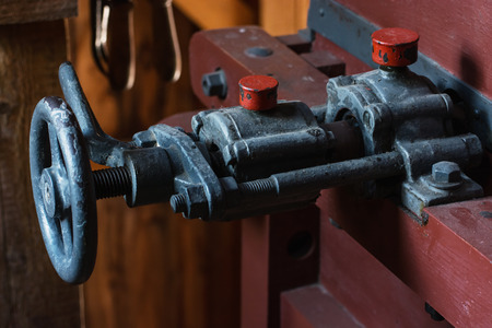 water mill: Valve of the old metal thread. Interior of an old water mill.