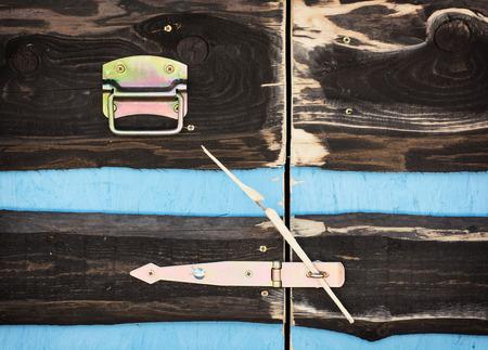 locked: Locked wooden doors. Detail photo.
