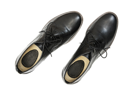New black leather shoes on the white background. View from above. Stock Photo