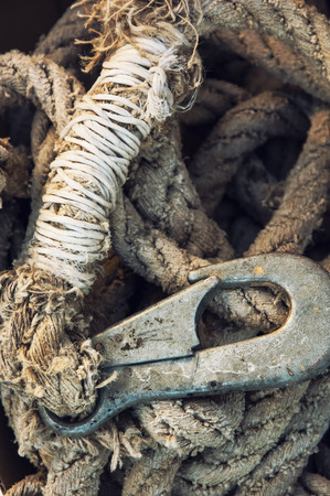 firmness: Rope with rusty hook. Industrial detailed photo. Stock Photo
