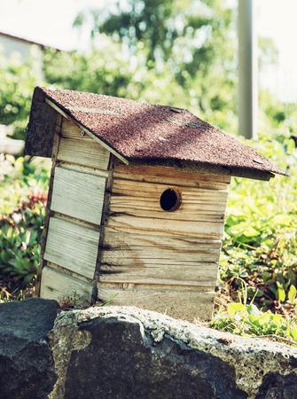 countrylife: Wooden birdhouse in the garden.