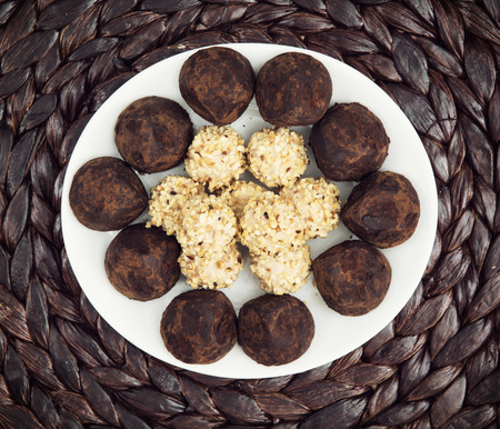 chocolate truffles: Chocolate truffles on the white plate. Food and drink. View from above. Stock Photo