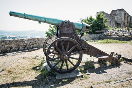 battleground: Rusty historic cannon in Trencin castle, Slovak republic. Editorial
